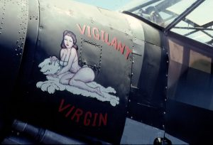 """In 1991, the L-1 emerged from painting at Stinson Airfield with a new green camo paint scheme and its """"Vigilant Virgin"""" nose art (a female figure seated on a white lion rug). Photo by Craig Parchman."""