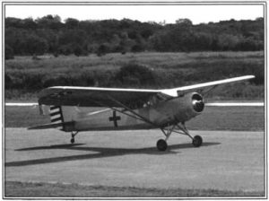 At the Kerrville, Texas EAA Fly-In in September 1983 is the Stinson L-1.