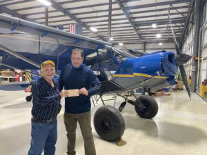 Mel Asberry hands Greg Rodriguez the airworthiness approval for his Super Legend XP.